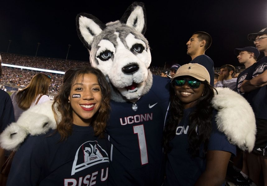 UConn mascot and fans at football game