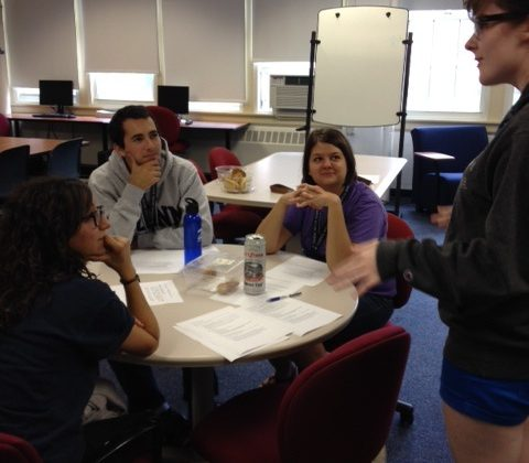 a tutor explains concepts to a group of students