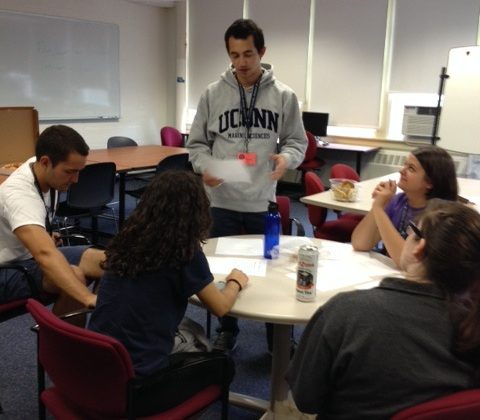 A tutor assisting a group of students