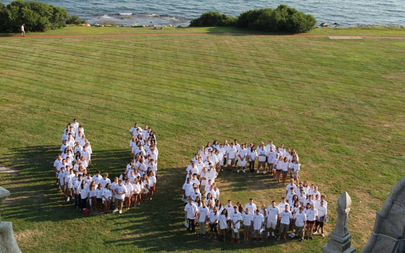 "Aerial of students forming the letters ""U"" and ""C"""