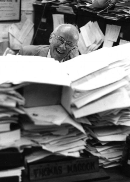 Jovial Magoon surrounded by files