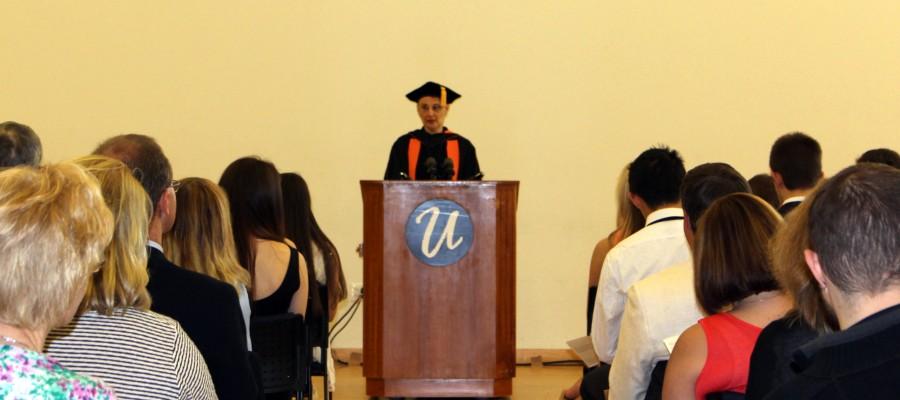Veronica Makowsky at podium, facing crowd