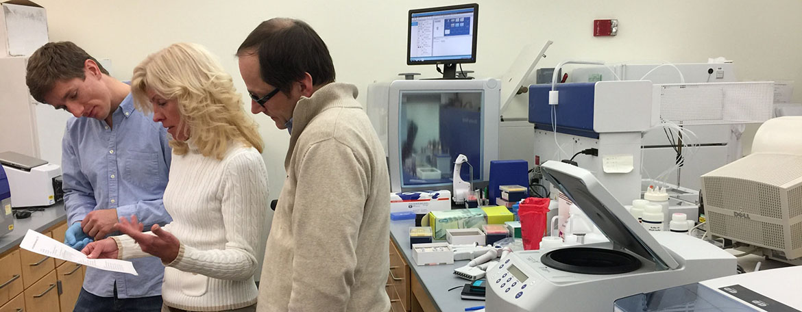 Susan Janton, M.S. Applied Genomics, and Dr. Joerg Graf, Professor, MCB, and Director, PSM Microbial Systems Analysis program, look over a PSM lab protocol
