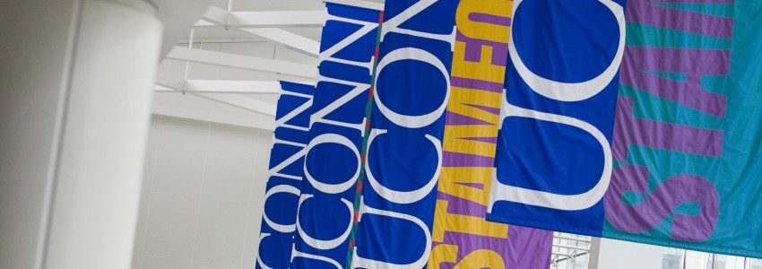 UConn Stamford banners haning in the Stamford campus atrium