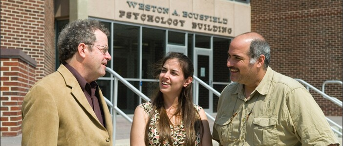 Professors David Kenny (left) and Seth Kalichman (right), with then-student Lisa Eaton (center). Photo from 2010.