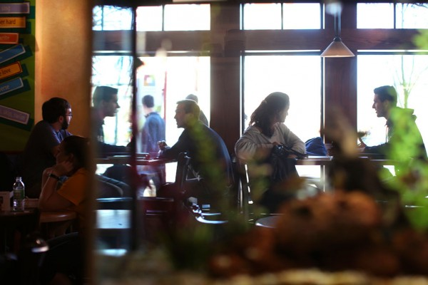 Students take a break inside the Dog Lane Cafe in Downtown Storrs
