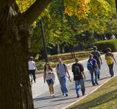 Students walking across campus on a fall day.