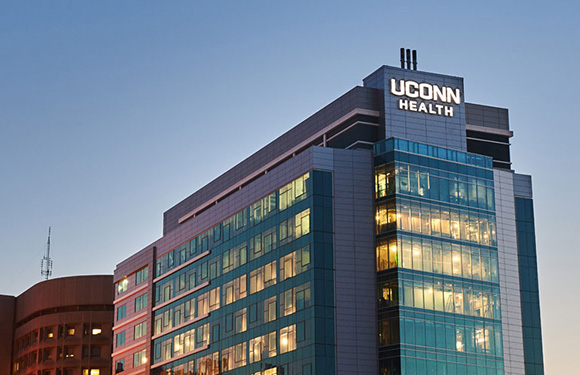 A night view of University Tower at UConn John Dempsey Hospital (Janine Gelineau/UConn Health)