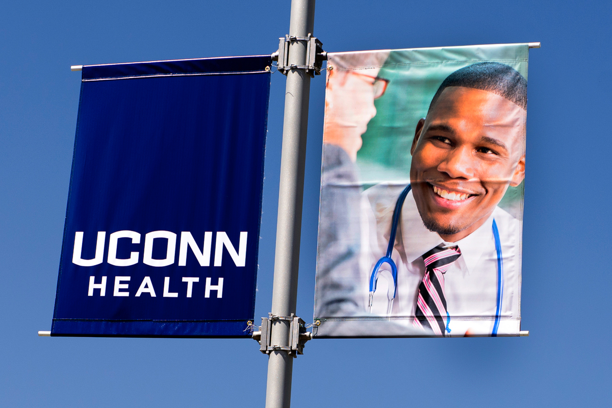 Physician examines patient, UConn Health