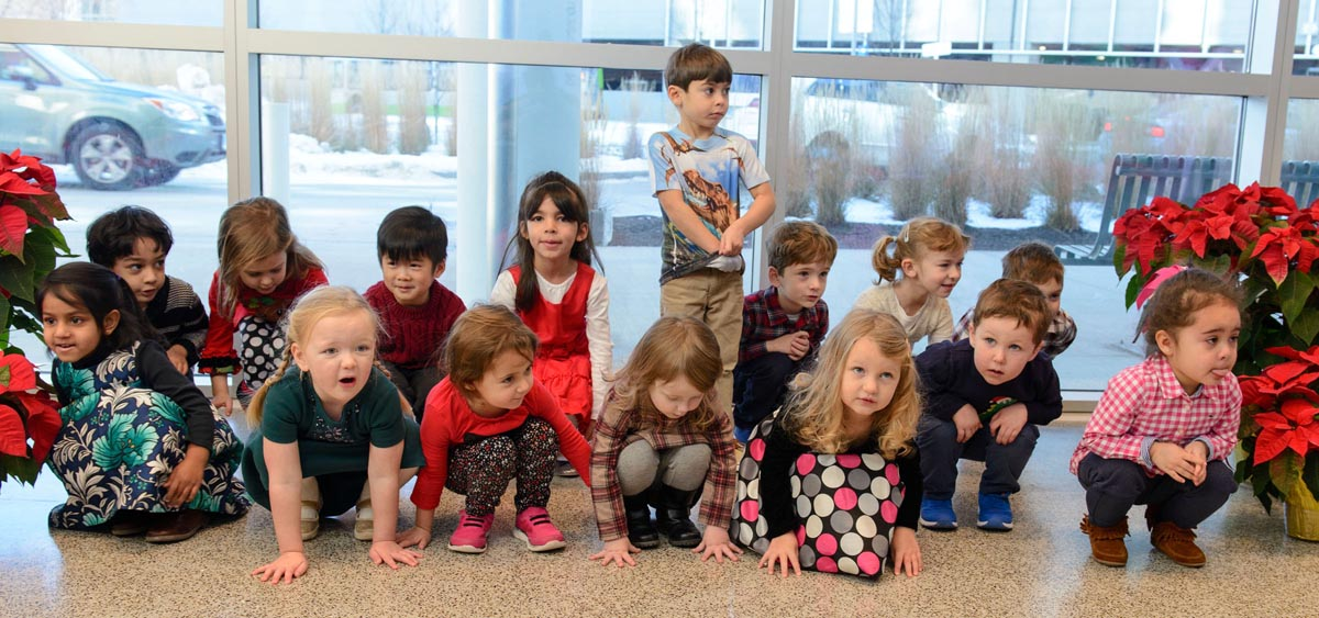 Preschoolers from the Child Care Center perform their holiday concert in the Outpatient Pavilion (Janine Gelineau/UConn Health)