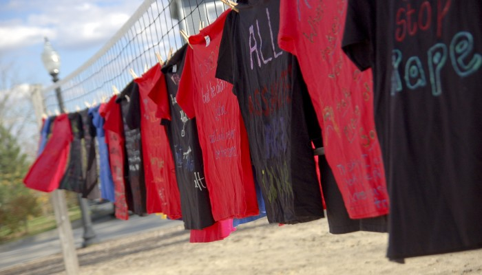 Colorful T-shirts strung up, decerated with incuraging messages for those effected by sexual assult